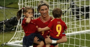 Spain's Torres holds his children Leo and Nora as he celebrates victory against Italy during their Euro 2012 final soccer match at Olympic Stadium in Kiev