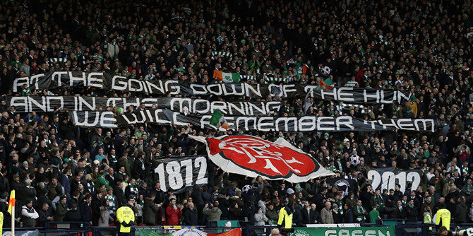 Celtic supporters display a banner at half time during their Scottish League Cup semi final match against Rangers in Glasgow, Scotland
