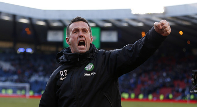 Celtic manager Ronny Deila celebrates winning their Scottish League Cup semi final soccer match against Rangers at Hampden Park stadium in Glasgow