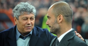 FC Shakhtar coach Mircea Lucescu (L) greets FC Barcelona coach Josep Guardiola prior their UEFA Champions League, quarter-finals, second leg football match in Donetsk on April 12, 2011. Barcelona won 1-0. AFP PHOTO / SERGEI SUPINSKY