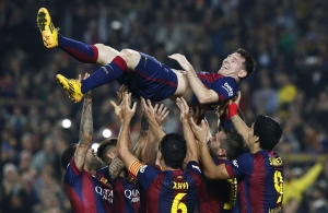 Barcelona's Messi celebrates his second goal with teammates during their Spanish first division soccer match against Sevilla at Nou Camp stadium in Barcelona