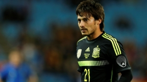 Spain's David Silva watches the play during a friendly soccer match against Italy at the Vicente Calderon stadium in Madrid, Wednesday March 5, 2014. (AP Photo/Paul White)