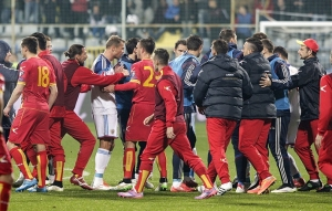 Russia's players scuffle with Montenegro's players during their Euro 2016 Group G qualifying soccer match in Podgorica