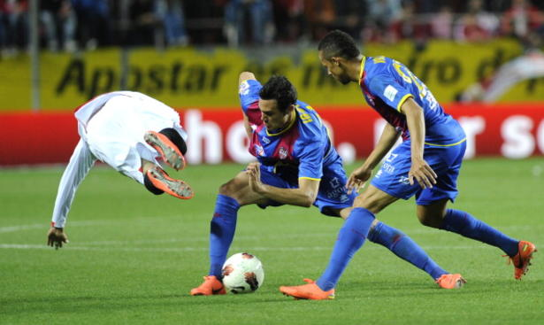 Sevilla's forward Reyes (L) falls as he