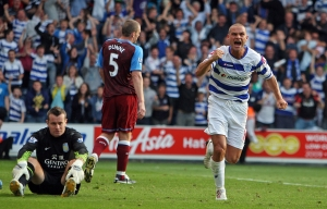 Luke Young of QPR celebrates Richard Dunne of Aston Villa's late own goal to make the score 1-1.