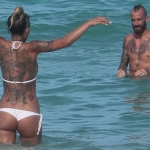 Former Liverpool and Chelsea midfielder Raul Meireles and wife Ivone wearing a white bikini on the beach in Miami