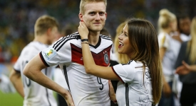 Germany's Andre Schuerrle is congratulated by girlfriend Montana Yorke after they won their 2014 World Cup final against Argentina at the Maracana stadium in Rio de Janeiro