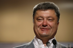 Ukrainian businessman, politician and presidential candidate Poroshenko speaks during his news conference in Kiev