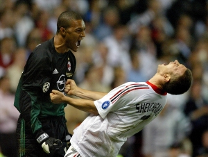 AC MILAN'S UKRAINIAN STIKER ANDRIY SHEVCHENKO CELEBRATES WITH DIDA AFTERSCORING THE WINNING GOAL ...