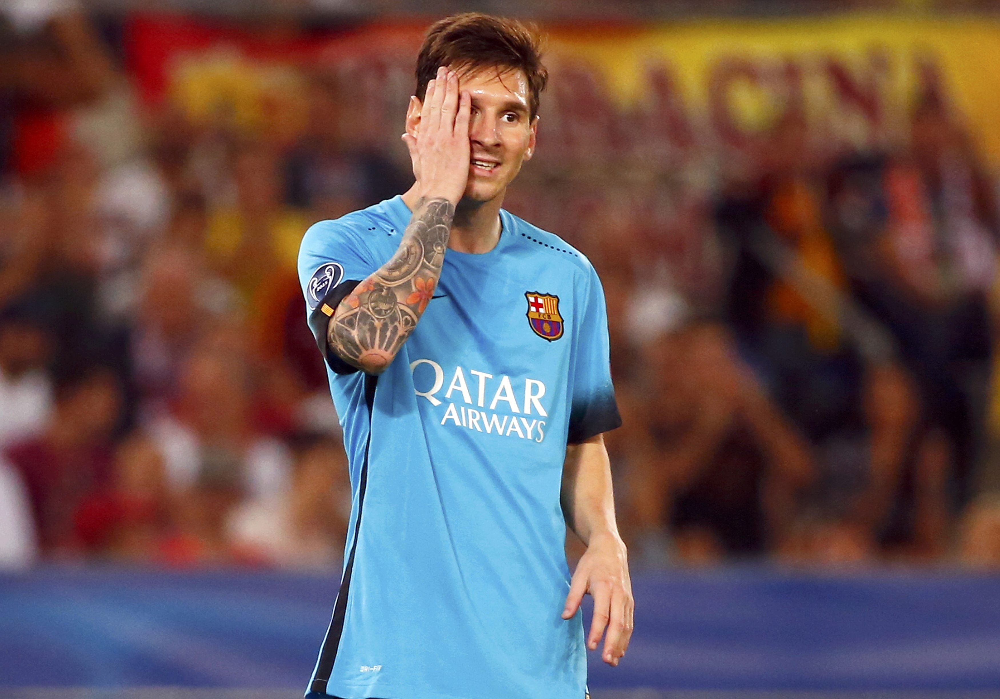 Barcelona's Messi reacts during the match against AS Roma in their Champions League match at the Olympic stadium in Rome