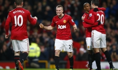 Manchester United's Rooney celebrates his goal against Sunderland with Cleverley during their English Premier League soccer match in Manchester