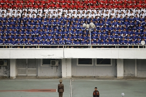 North Korean fans watch their team's preliminary 2018 World Cup and 2019 AFC Asian Cup qualifying soccer match against Philippines at the Kim Il Sung Stadium in Pyongyang