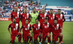 Gibraltar's players pose for a picture before their Euro 2016 qualification soccer match against Poland in Faro