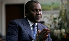 Founder and Chief Executive of the Dangote Group Aliko Dangote gestures during an interview with Reuters in his office in Lagos